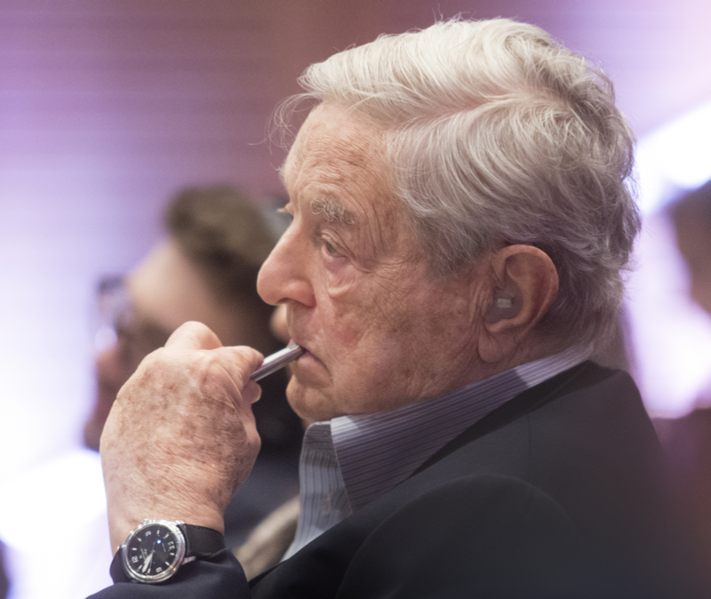 George Soros smoking a cigarette