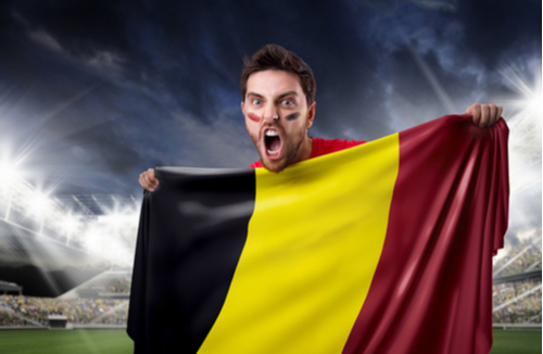 Belgian soccer fan holds Belgian flag