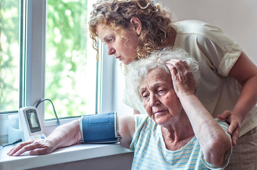 caregiver with elderly patient