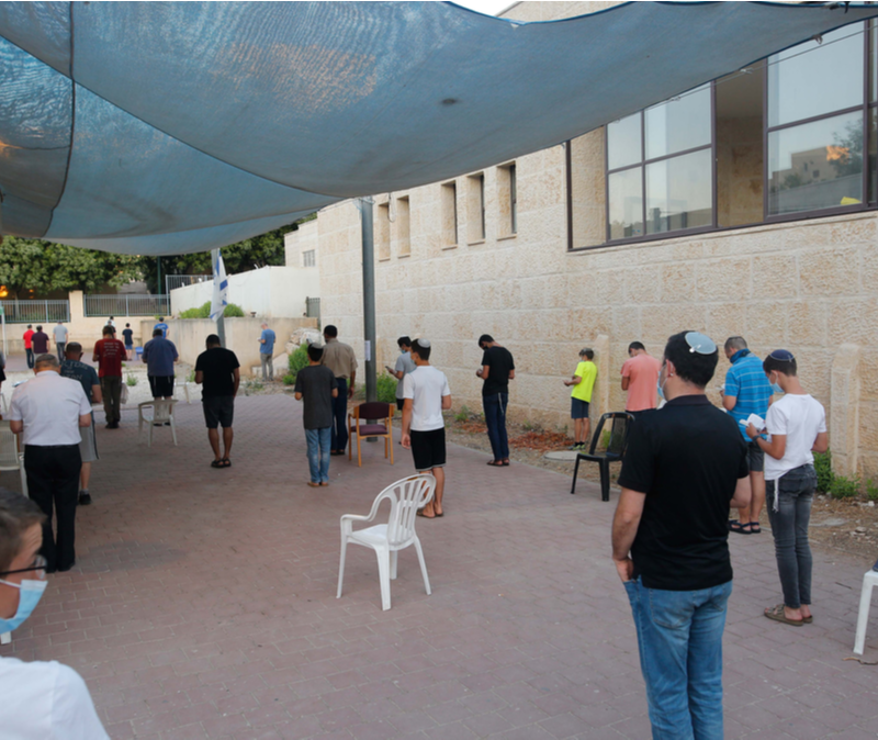 Jewish Israelis pray out of doors during coronavirus epidemic
